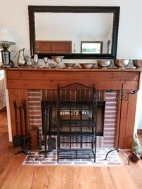 Pewter bowls, pitchers and lamp. Black framed mirror, black wrought iron shelves, fireplace irons, candleholders.
