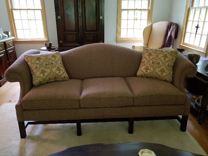 Upholstered couch in taupe.