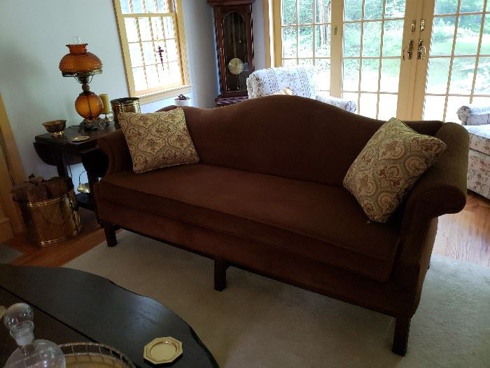 Upholstered couch in burgandy.