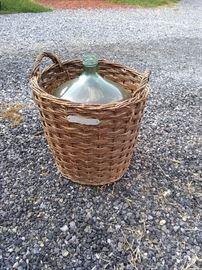 Vintage carboy/demijohn bottle with basket
