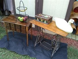 Upscaled vintage tables made from antique sewing machines. Wire fruit stand, foreign wood painted box, large swan.