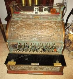 Antique National cash register, stone piece is cracked.