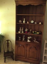 Rock maple hutch with a few collectibles. Also shown is a vintage child's rocker