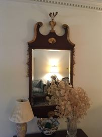 Distinctive mahogany framed Mirror with gold trim