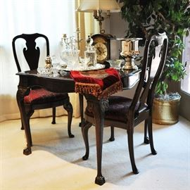 Queen Anne style card or game table with extra leaf stored below - accessories include a fine Bulova mantle clock with strike and chimes (key wind).  There is also a fine Sligh mantel clock also.