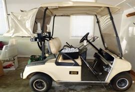 Vintage Club Car Golf Cart with Cover attachment at rear for golf bag protection and Cover for entire cart.