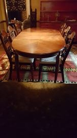 Dining Table and 6 chairs. Comes with two leaves. Show fully extended