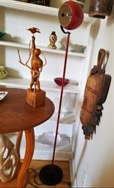 cool red lamp with primitive items