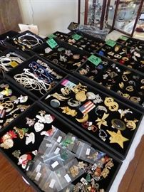 Lots of jewelry along with interesting dragon figurines collection