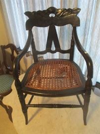 Antique child's chair, cane seat, ebony finish, (damaged)