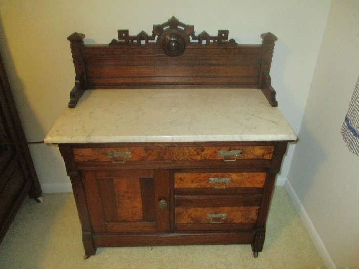 Antique Victorian Bedroom Set, Circa 1875, walnut with burl veneer, ornate floral carving, includes bed, dresser with mirror and commode, dresser and commode have marble tops