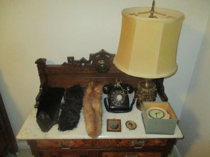Fur collars, vintage telephone, table lamp and clock