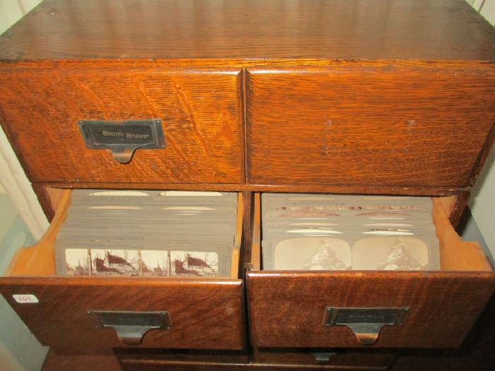 Oak Cabinet, all drawers are filled with stereoscope cards and the bottom drawer has 2 viewers