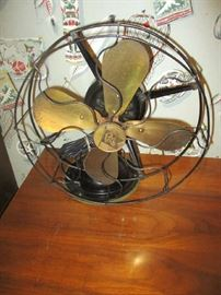 Antique fan, brass blades