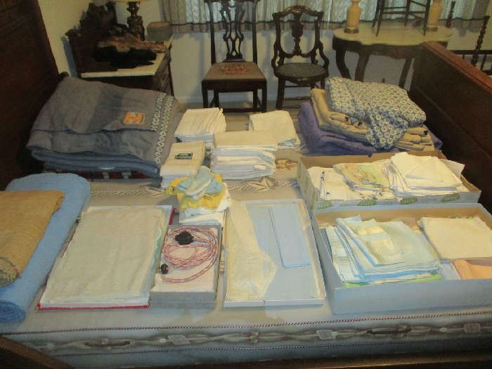 Antique bedding, hankies and napkins
