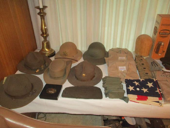 Assorted military hat, helmets and clothing