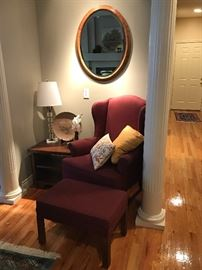 Upholster chair and ottoman, oval  beveled mirror, crystal lamp, etc.