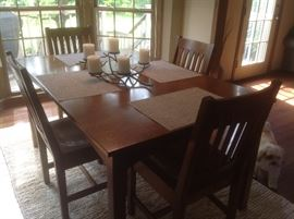"Stickley table, 2 leaves and four chairs.  40w, 62 L , 30H.  Leaves are 15"" each.  Original price $6000"