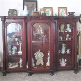 Beautiful Antique Carved Mahogony One Piece Fopted Glass Display Cabinet.  Lots of collectible storage space.