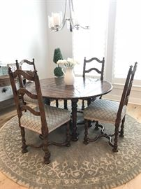 Custom made dining table and 4 chairs. Table is round with drop leaves to make it square. Originally purchased for $10,000. Estate sale price: $1,250. ........ more pictures available at the end of the gallery.