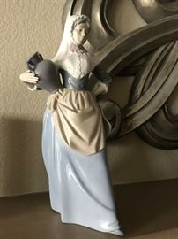 Nao by Lladro. 1985. Woman with water jug. Rare. Purchased in Spain. $100.