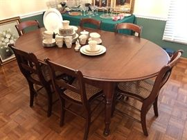 Antique Table with leafs and pads and 6 Chairs