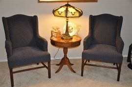 Navy print upholstered Wing Back Side Chairs shown with a fantastic antique side table and great crystal pieces!