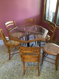 Glass top octagon table and 6 Victorian cane chairs
