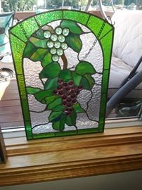 Grape stained glass nine and a half inch wide by 13 and 1/2 in tall