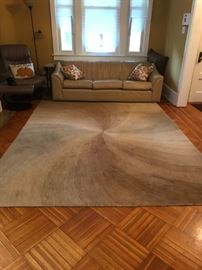 Area rug and sofa