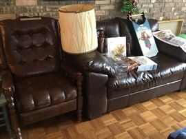 Large vintage chair and a leather loveseat in Black