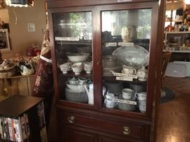 "China cabinet - 91 pc set of Sango ""Cahill""; 40 pc set of Favolina ""Moss Rose"";8 pc set of Anchor Hocking glasses; egg cups, Red ruby Boopie glasses and more"