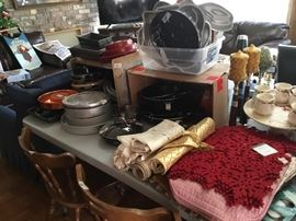 Cookware of all kinds, 4 oak chairs, placemats, etc