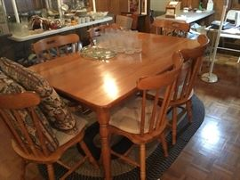 Dining room oak table with 6 chairs; nice set of glasses and large platter