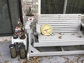 Miscellaneous items on patio and wooden swing