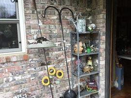 Patio - shepherd's hook , metal shelf full of garden items