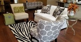 pristine little white sofa/loveseat, cute chairs, Zebra design rug