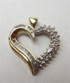 10k gold heart pendant with baguette and single cut channel set diamonds. 2.6 grams