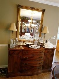 Beautiful sideboard and gold leaf mirror
