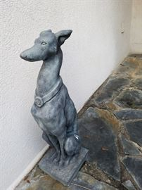 Greyhound dog outdoor statue