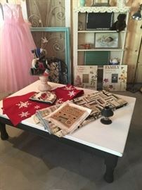 Vintage linens, refinished coffee table, vintage patch-work teddy bear, vintage dress, turquoise frame, vintage metal screen door, vintage shelving unit,  various pictures.