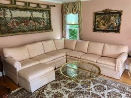 Ethan Allen pink sectional sofa, wall tapestry & glass & brass cocktail table