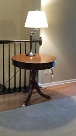 Mersman Duncan Phyfe style Drum Table with a Stiffel lamp