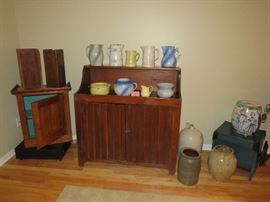 A Primitive Dry sink loaded with crocks and stoneware