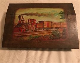 a very nice mans dresser box with train decoupage on the lid. Made to hold a man's whatnot's and jewelry.