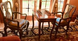 """1. Pair of Maitland Smith Oak Carved Arm Chairs w/ Leather Seat (24"""" x 23"""" x 40"""")                                                            2. Maitland Smith Burlwood Inlay Game Table w/ Ornate Brass Detail (32"""" x 22"""" x 30"""")"""
