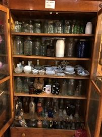 Vintage bottle collection along with marbles