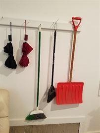 Umbrellas, brooms, shovel
