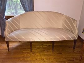 """Unique antique parlor sofa, rounded back with slightly curving arms. professionally reupholstered, ivory.  Left top of arm to right side arm is 70"""", approximately 30"""" deep, back tallest point of back is approximately 36""""."""