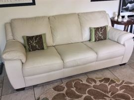 Matching Natuzzi Leather Living Room Suite: Chair, Loveseat, and Couch.